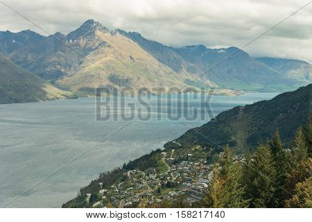 Aerial view of Queenstown in South Island New Zealand. Cityscape and Landscape of queenstown with lake Wakatipu from top new zealand south island.