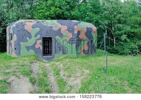 Old military bunker on the forest edge built before WWII in Krkonose mountains in Czech Republic