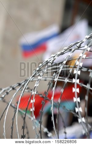 Protests in Eastern Ukraine . barbed wire on the background of the flag of Russia region