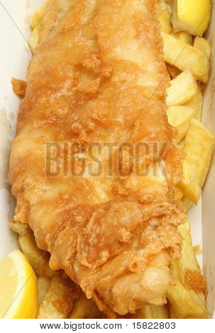 Cod fillet with chips in takeaway food container.