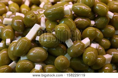 Green Pitted Stuffed Olives In Oil Close Up