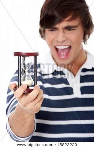 Young man with hourglass. Isolated on white background.