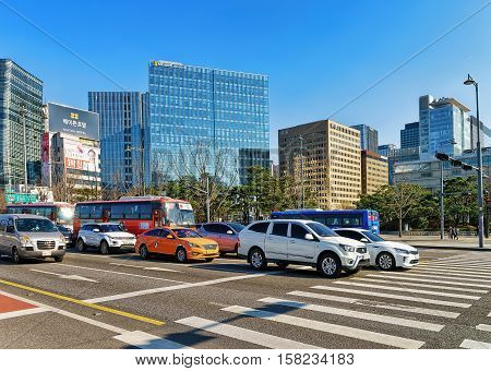 Car Traffic Pedestrian Crossing And Modern Skyscrapers In Jung District