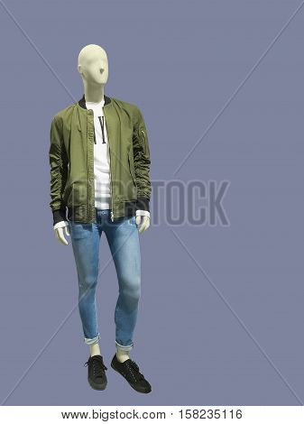 Full-length male mannequin dressed in jacket and jeans over gray background