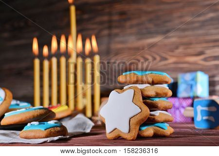 Close up view of tasty cookies for Hanukkah on wooden table