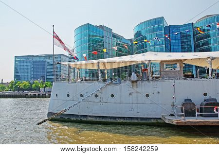HMS Belfast and Thames River in London in UK. It is a museum ship.