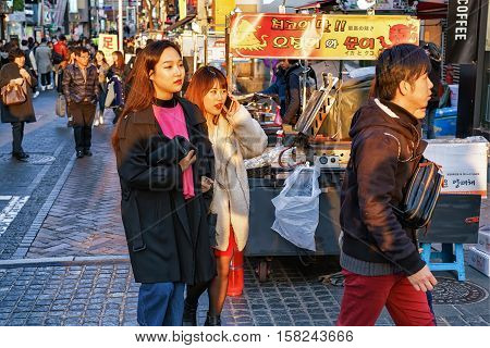 Korean Young People At Myeongdong Open Street Market In Seoul