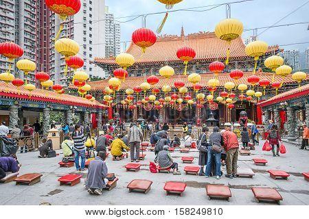 People Praying In Wong Tai Sin Temple In Kowloon Hk