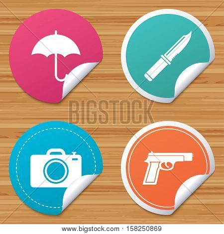 Round stickers or website banners. Gun weapon icon.Knife, umbrella and photo camera signs. Edged hunting equipment. Prohibition objects. Circle badges with bended corner. Vector