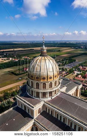 Dome of the Sanctuary and Basilica of Our Lady of Sorrows, Queen of Poland, in Lichen. The biggest church in Poland and one of the largest in the World in small village. Famous pilgrimage site. Aerial view