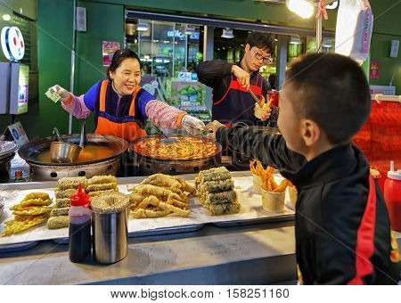 Purchase Of Seafood At Myeongdong Open Street Market In Seoul