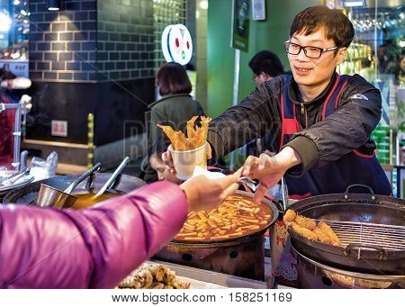 Purchase Of Seafood In Myeongdong Open Street Market In Seoul