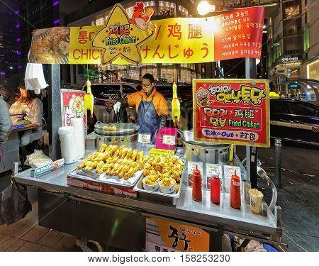 Seller Of Fried Chicken In Myeongdong Open Street Market Seoul