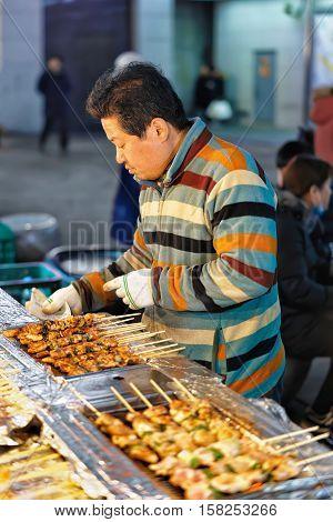 Seller Of Kebab Skewers At Myeongdong Street Market Seoul