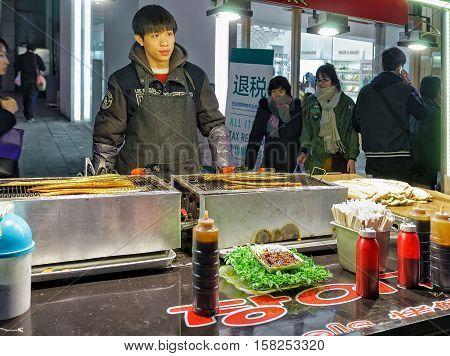 Seller Of At Myeongdong Open Street Market In Seoul
