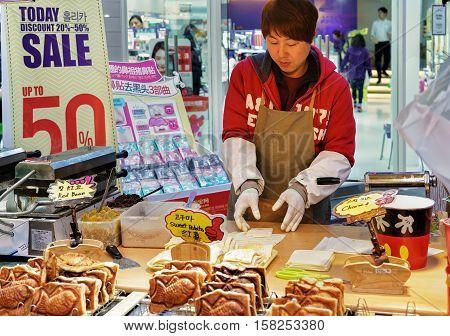 Seller Of Buns In Myeongdong Open Street Market In Seoul
