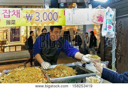 Seller Of Noodle In Myeongdong Open Street Market In Seoul