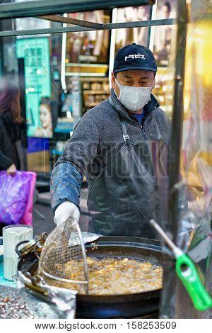 Seller Of Street Food At Myeongdong Street Market In Seoul