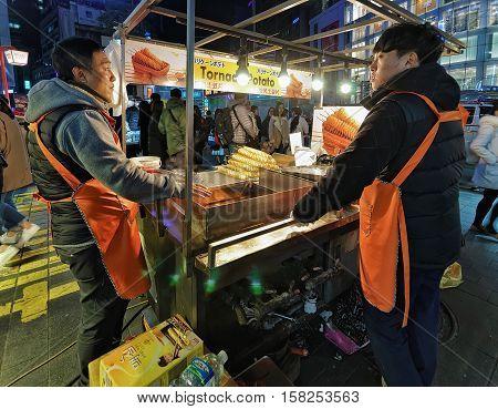 Sellers Of Potato Chips At Myeongdong Open Street Market Seoul