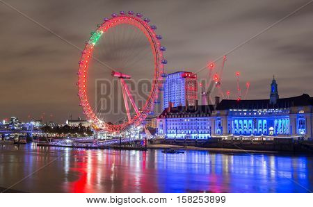 London United Kingdom-November 12 2016 : The London County hall is the site of business and attraction on the South bank of the River Thames.The London Eye is a giant wheel and the most popular attraction in the UK.