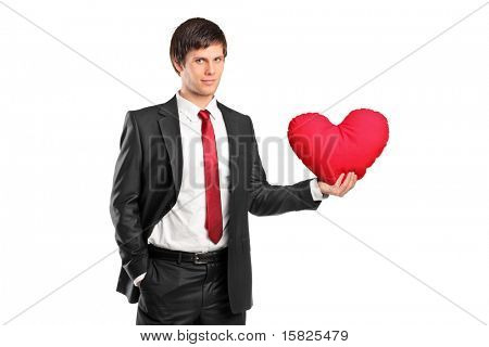 A man holding a red heart-shaped pillow isolated on white background