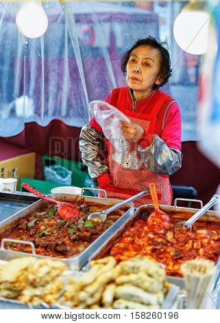 Woman Seller Of Street Food At Myeongdong Open Street Market