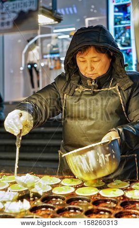 Woman Selling Food In Myeongdong Open Street Market In Seoul