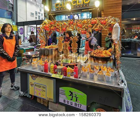 Woman Selling Seafood In Myeongdong Open Street Market In Seoul