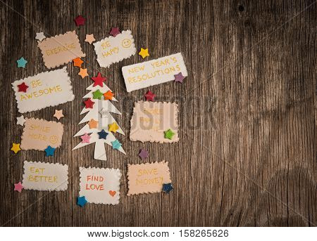 New Year's Resolutions And Christmas Tree On Vinatege Wooden Backgroun
