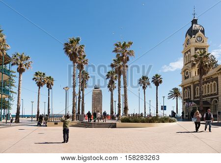 Adelaide Australia - August 28 2016: Many tourists and visitors wandering around the square at Adelaide beachside suburb of Glenelg Australia.