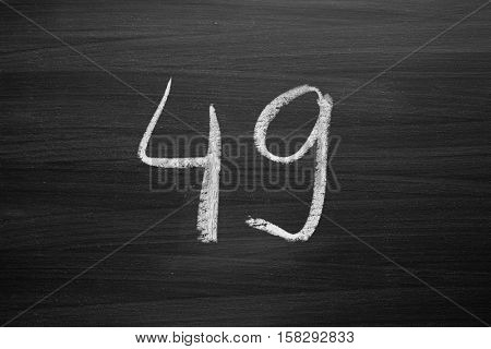 number forty nine enumeration written with a chalk on the blackboard