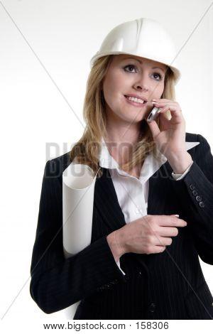 Architect On The Phone Holding Blueprints