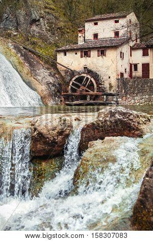 Old ancient mill Vecchio Mulino della Croda at flowing stream in Refrontolo town. Veneto region. Prosecco. Italy. Spring landscape with water over stones