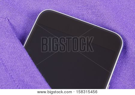 Black mobile phone smartphone with blank screen in pocket purple sweatshirt electronics