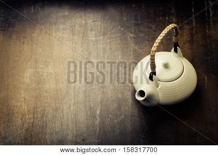 Image of traditional eastern teapot on rustic background