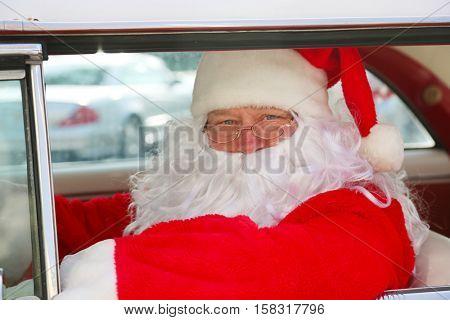 Santa Claus drives his Hot Rod Car. Santa Drives his car. Santa Claus arrives in style. Santa Cruises in his Classic Car. Santa Claus Drives. Santa Claus Car. Santa Car.