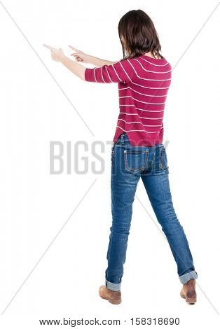 Back view of  pointing woman. beautiful brunette  girl in sweater. Rear view people collection.  backside view of person.  Isolated over white background.