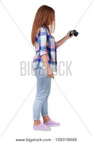 Back view of woman photographing. girl photographer in jeans. Rear view people collection.  backside view of person.  Isolated over white background.