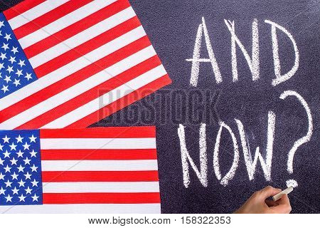 And Now  on the chalk board and US flag. Election concept