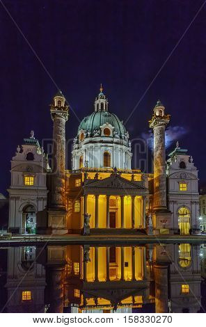 Karlskirche (St. Charles Church) has garnered fame due to its dome and its two flanking columns of bas-reliefs Vienna Austria. Evening