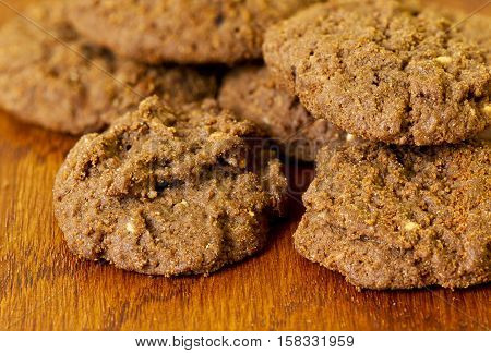 American nut cookies on a wooden textured background in soft window light
