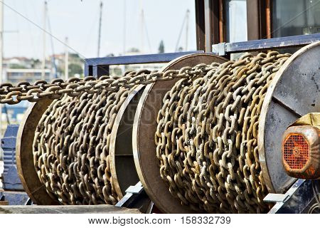 chains on a fishing vessel used to raise and lower the anchors