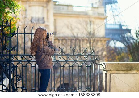 Photographer Taking Picture Of The Eiffel Tower