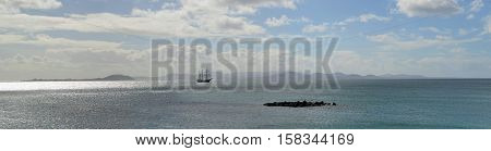 Ocean Panorama Square Rigged Tall Ship with the Northern Coast of Fuerteventura and the Island of Lobos in the Background.