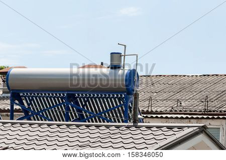 Contemporary hot water panels on a house in summer day