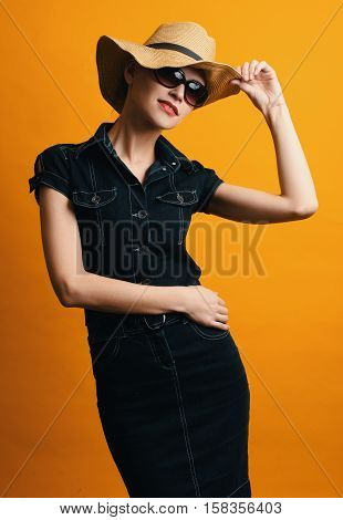 Fashionable Woman Wearing Denim Dress And Sunglasses