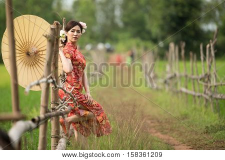girl with dress traditional Cheongsam concept in Garden