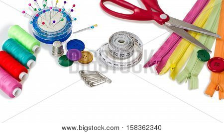 Sewing tools - scissors, buttons, sewing pins, sewing needle, safety pins, zippers, thread and fabric