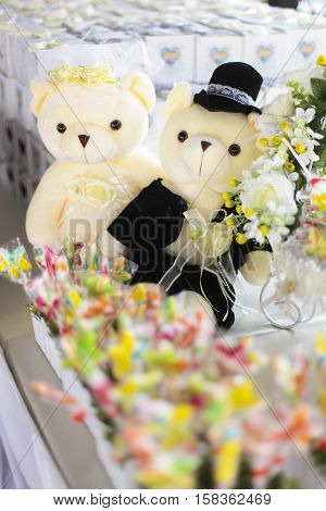Couple of Teddy bear with colourfull candy.