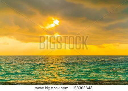 Beautiful sunset with sky over calm sea  in tropical Maldives island